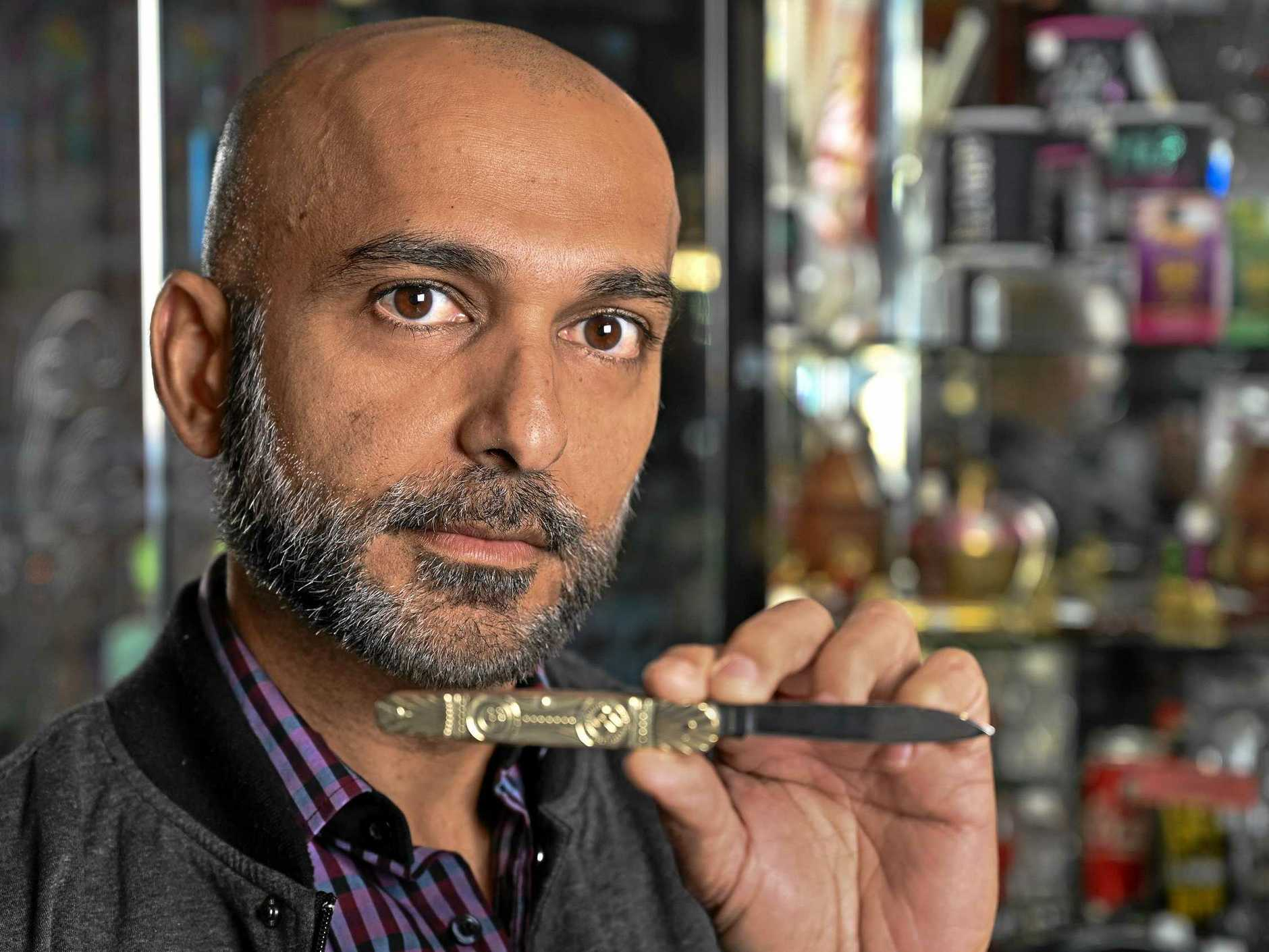 Owner of TSG Tobacco at Booval Fair Hitesh Khatri was mistakenly selling a knife with Nazi symbols.