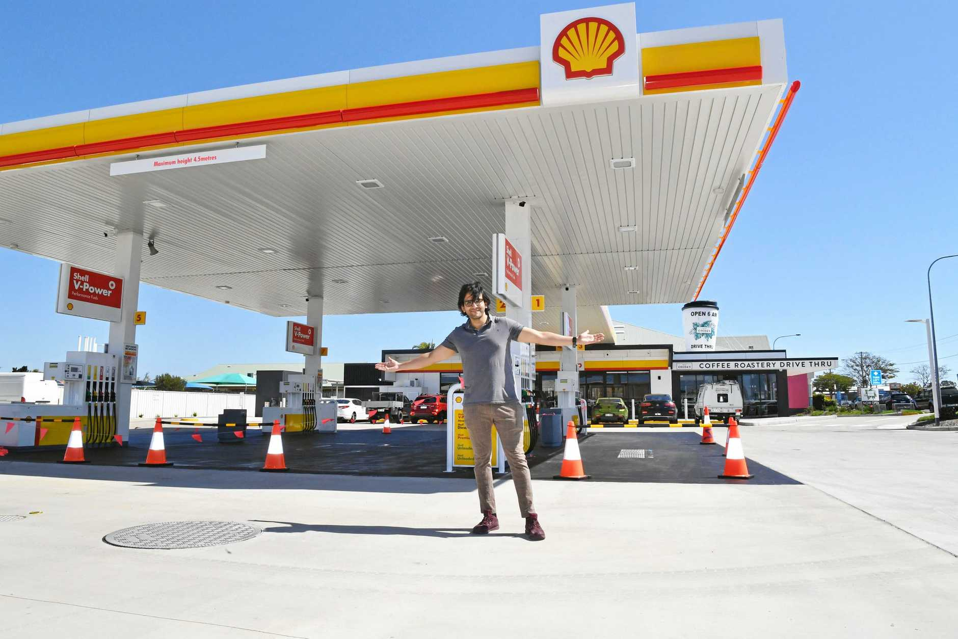 DATE CLAIMER: Boat Harbour Dr Shell servo manager Aayush Sengar outside the Hervey Bay station. Mr Sengar said the new servo will open tomorrow.