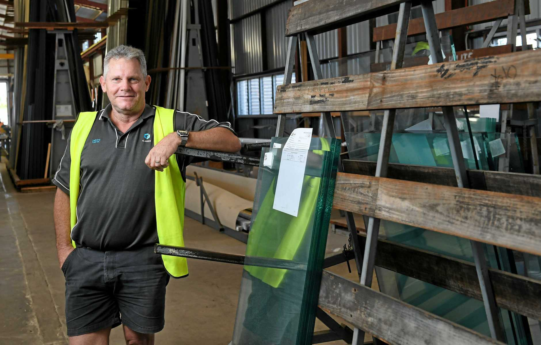 PROUD: Steve Jones was one of the glaziers from G. James who replaced the glass in the Ipswich post office clock tower after the heat from the Reids fire melted the clockface in 1985.
