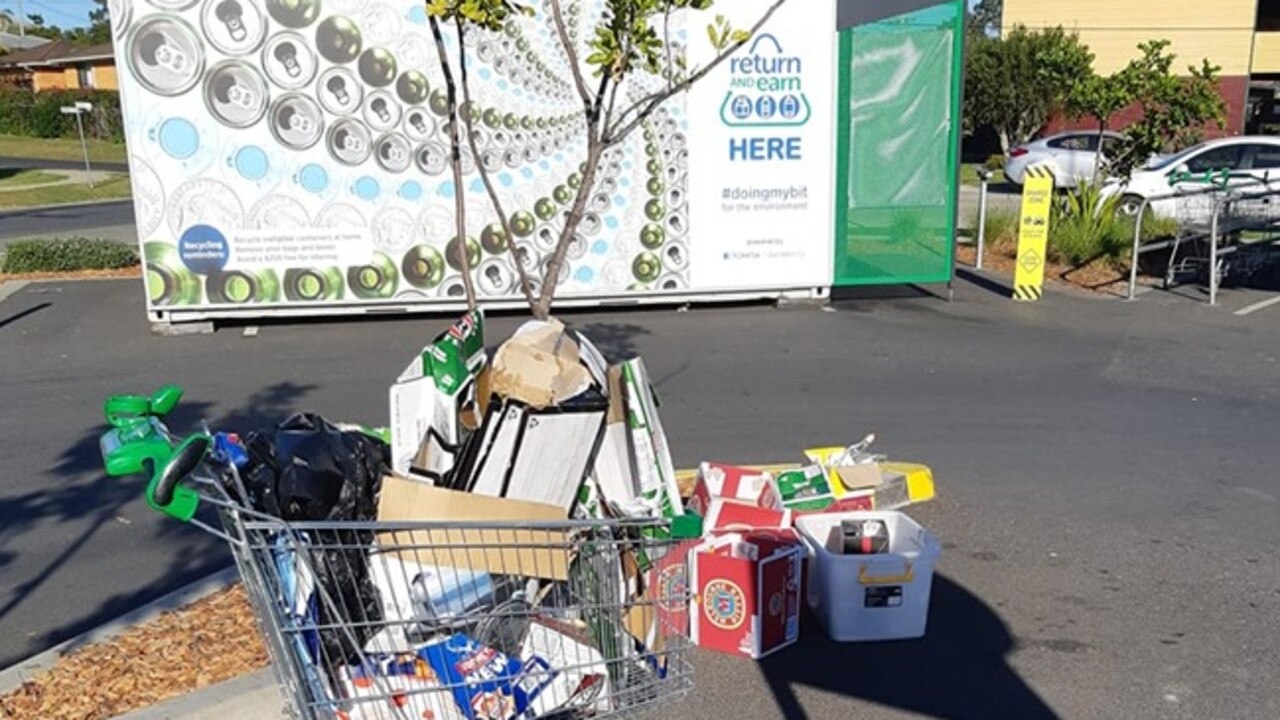 Empty boxes dumped near the Return and Earn vending machine at Woolgoolga Woolworths.