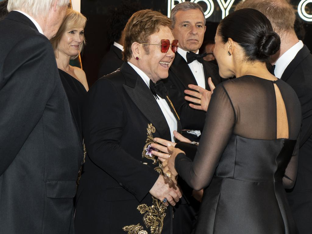 Sir Elton and the royals. Picture: Getty