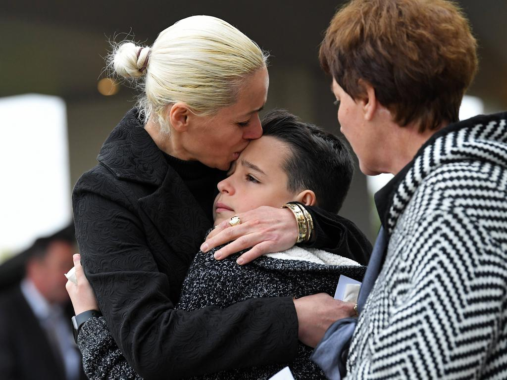 Sabrina Lekaj's brother Pyrrhus being comforted by mother Romina and grandmother at her funeral. Picture: Tom Huntley