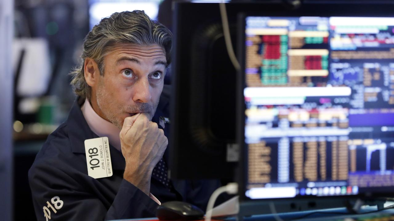 Trader John Romolo worked on the floor of the New York Stock Exchange last Wednesday as stocks dropped after the bond market threw up another warning flag on the economy. Picture: Richard Drew/AP Photo