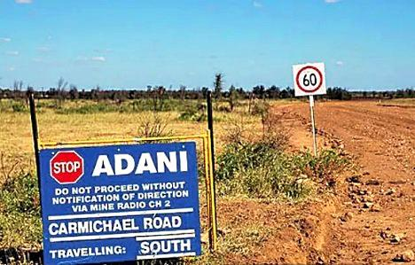 A risk analysis company has warned that investing near the Adani mine would be very risky. But a local agent said with risk, sometimes comes reward.