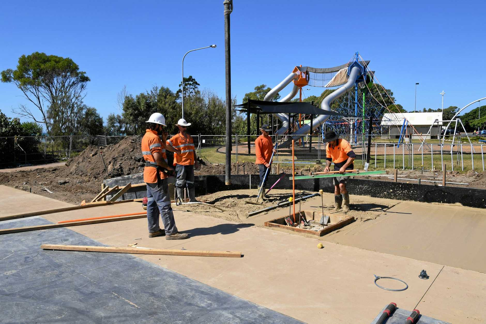 Construction workers putting the final touches on the skate park ahead of its opening date next month.