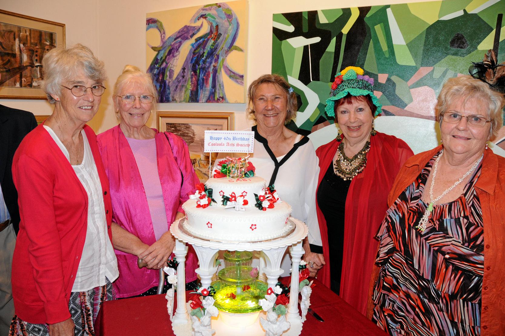 Cooloola Arts Society 40 year celebration with the Queensland Governor. Art Society members admire the celebratory cake made by Deana Liddle.  Yvonne Manger, Cecile Steenbergen, Lee McGruer, Violette Jameson OAM, Lyn Ballantyne. Photo Tanya Easterby / Gympie Times