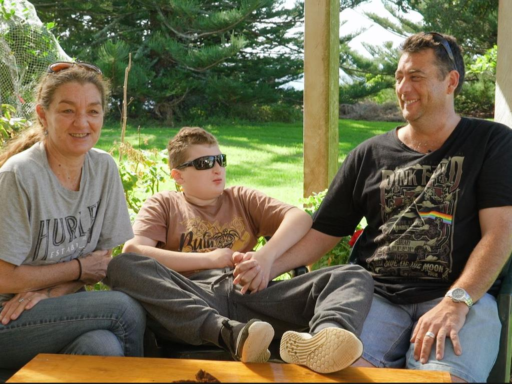 JJ with his mum Nicole and dad Joel at home on Norfolk Island.