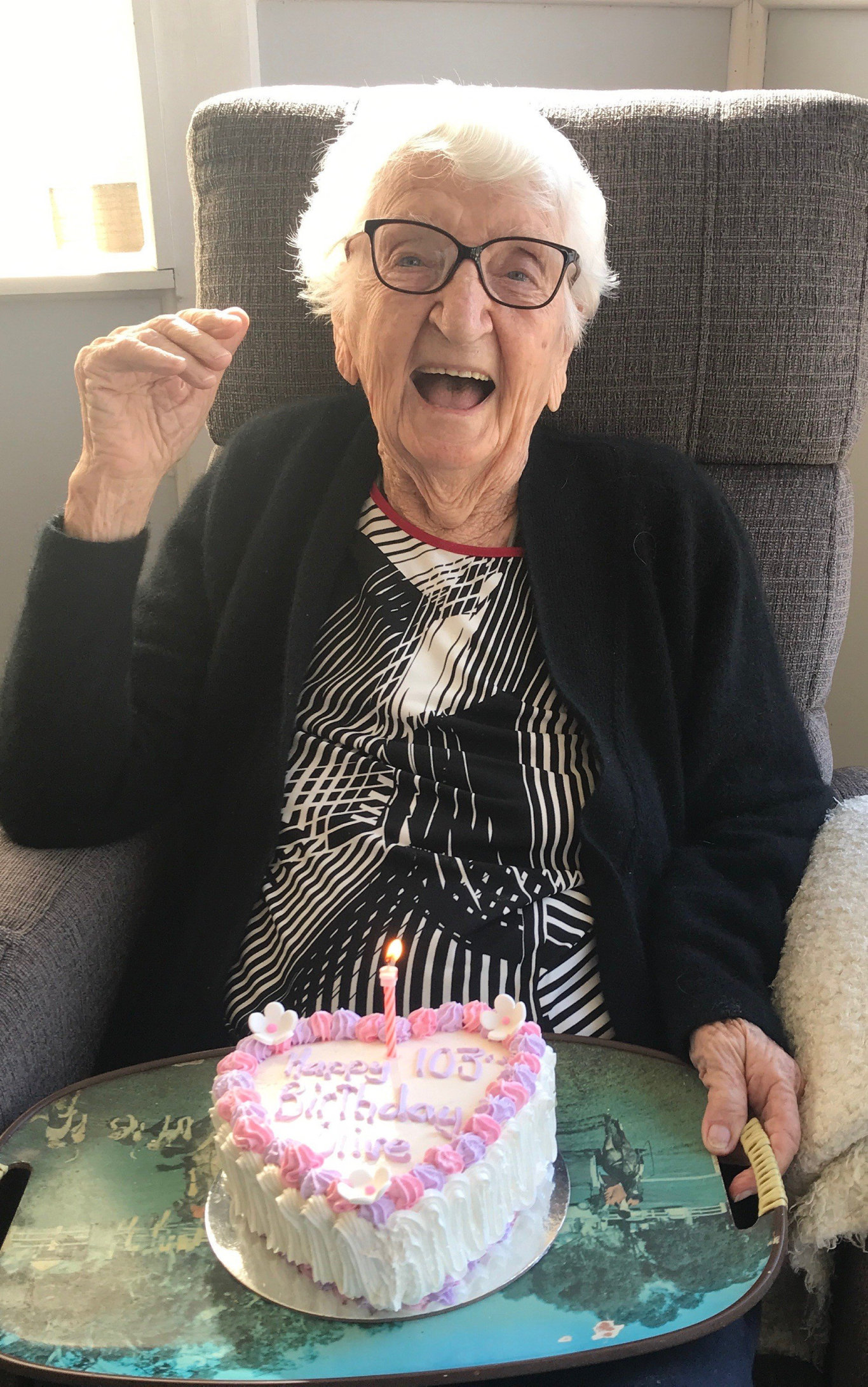 ALL SMILES: Maryborough's Olive Williams with a birthday cake celebrating her 103rd birthday.