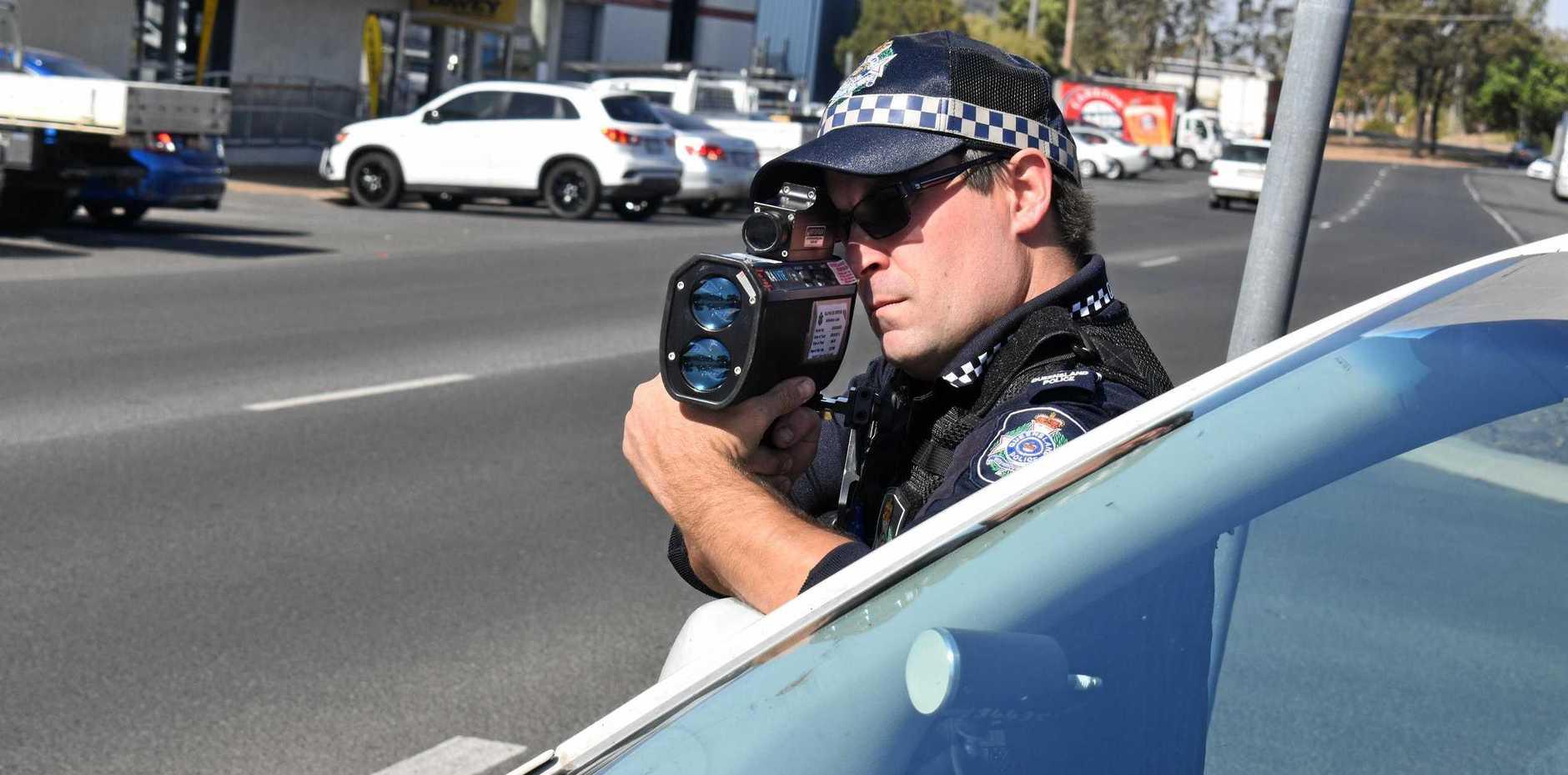 Senior Constable Matt Reichstein takes aim at speeding drivers