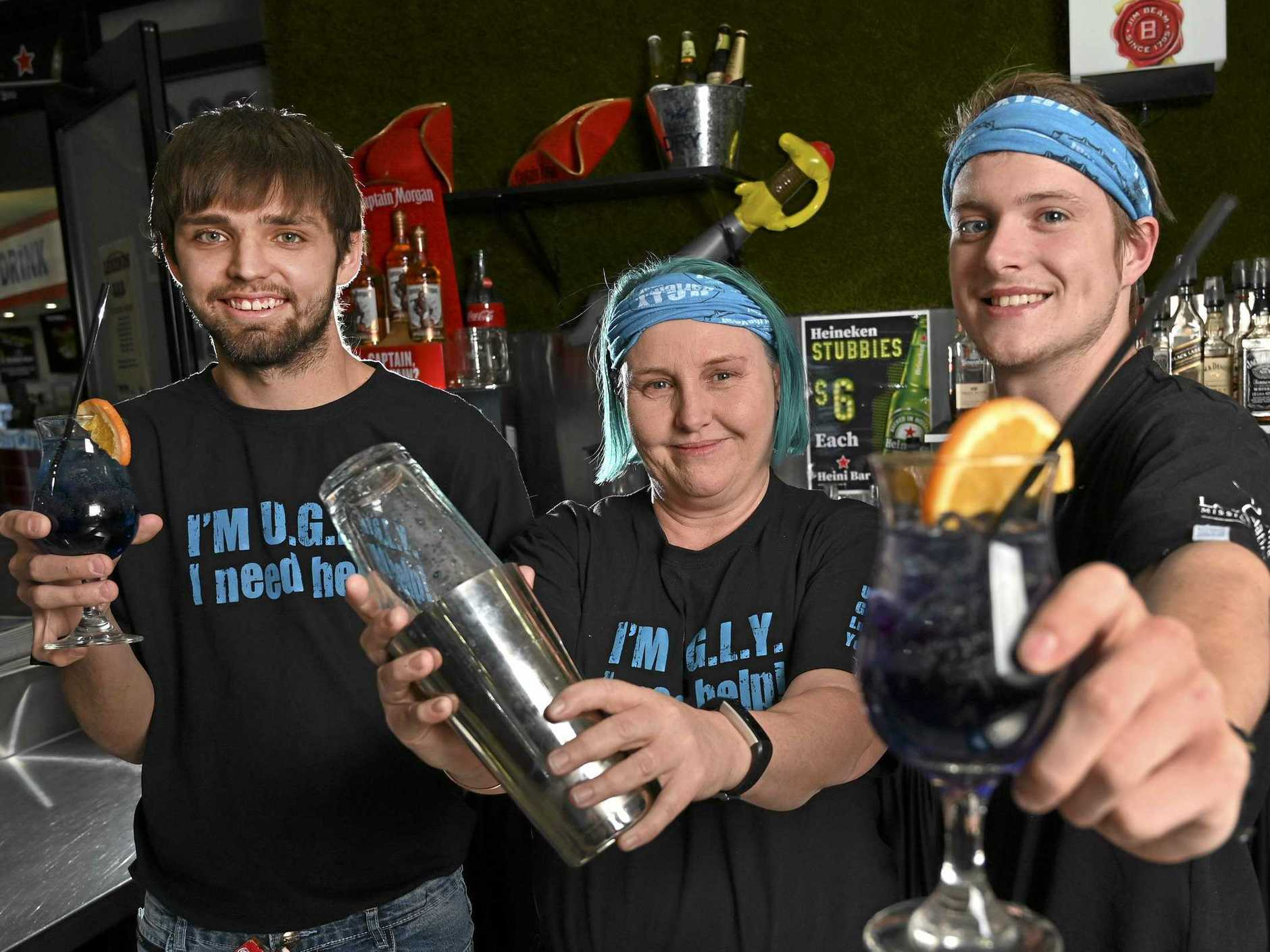 JOIN THE FIGHT: Brady McKeough, Barb O'Connell and Nathan Moulds are all bartenders at Goodna Services Club, who will take part in the U.G.L.Y Bartender cause on Sept 6.