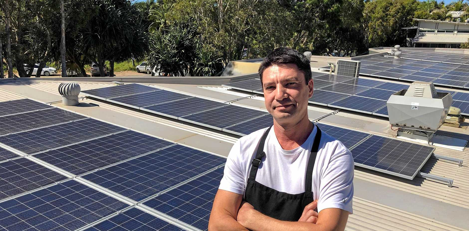 SOLARISED: Christian Poulsen, owner of the Belongil cafe/restaurant with his solar panels pumping.