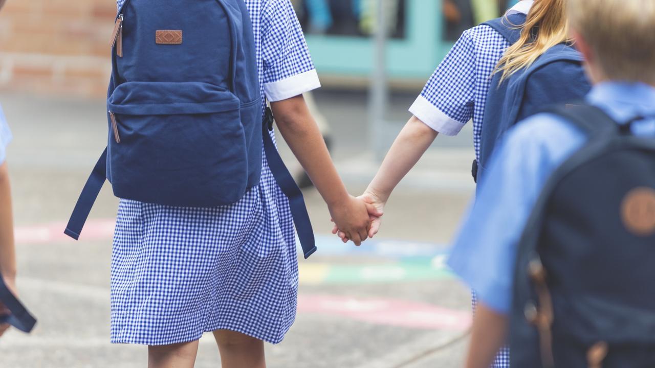 School children walking away.