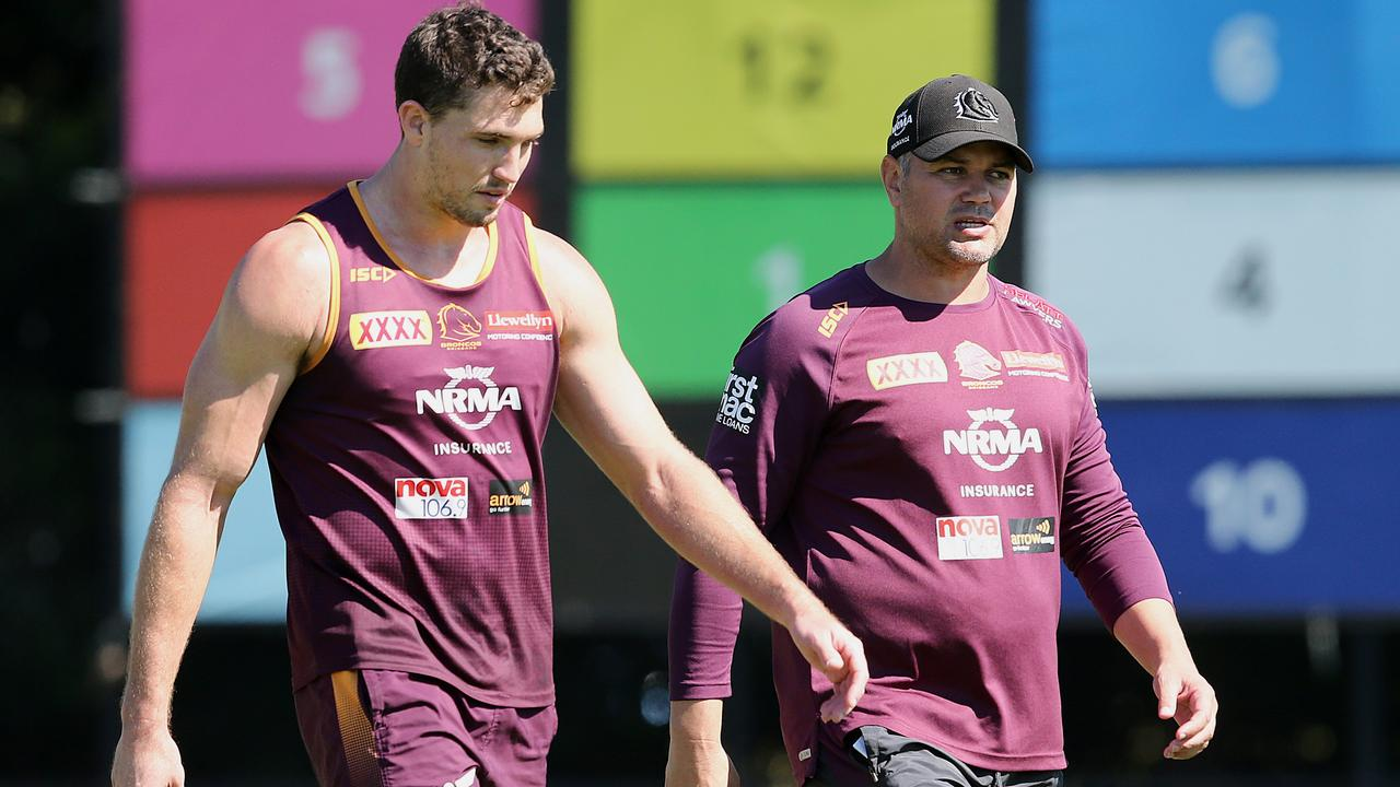 Anthony Seibold (right) talks with Oates during a training session this month. Picture: AAP Image/Jono Searle