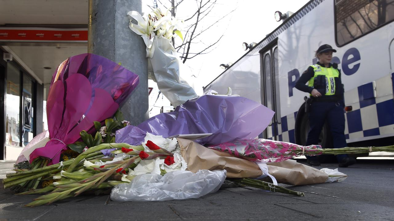 Flowers outside the shop where North Hobart grocer Voula Delios was murdered. Picture: KIM EISZELE