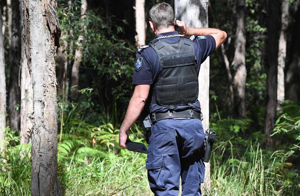 Poilce and SES search the Dularcha National Park in the Mooloolah Valley for missing teenager Michael Ryan. Photo: Warren Lynam