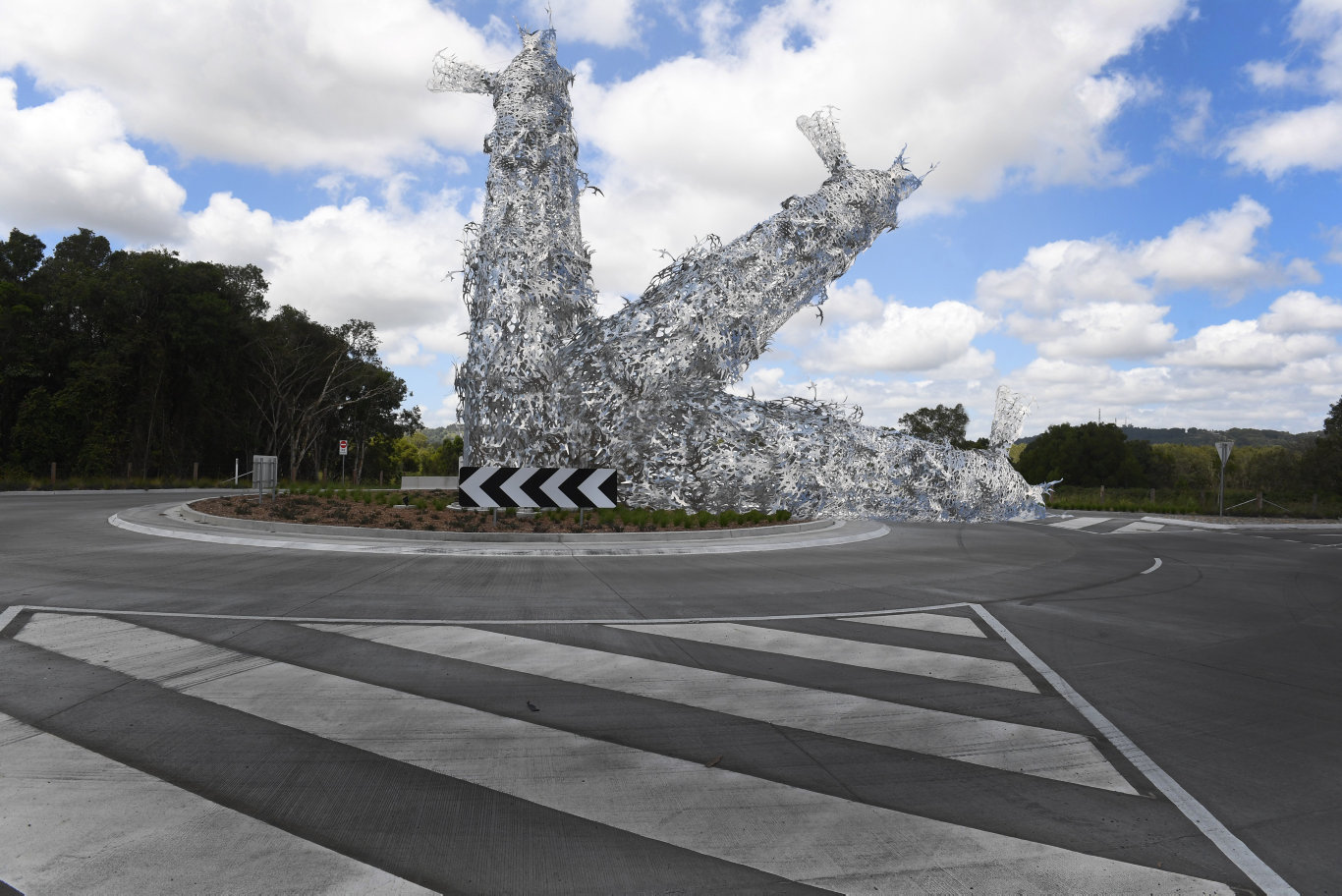 The final stage of the installation of Corey Thomas' 12 metre tall lighthouse sculpture on the new Bayshore Drive Roundabout at Byron Bay.