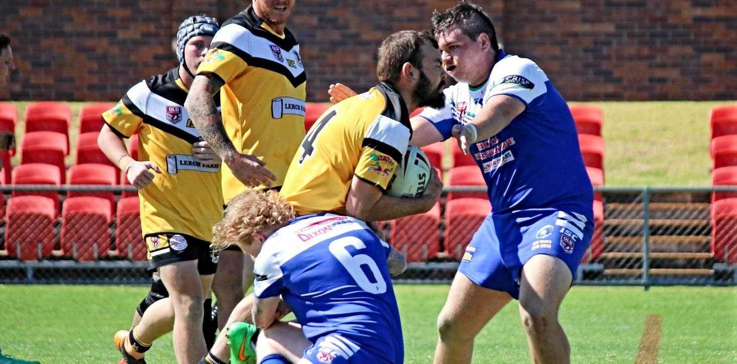 TOUGH SLOG: Gremlins players Jarrod Irwin and Will McPaul attempt to wrap up this Hawks bolter in their close encounter on Sunday in Toowoomba.