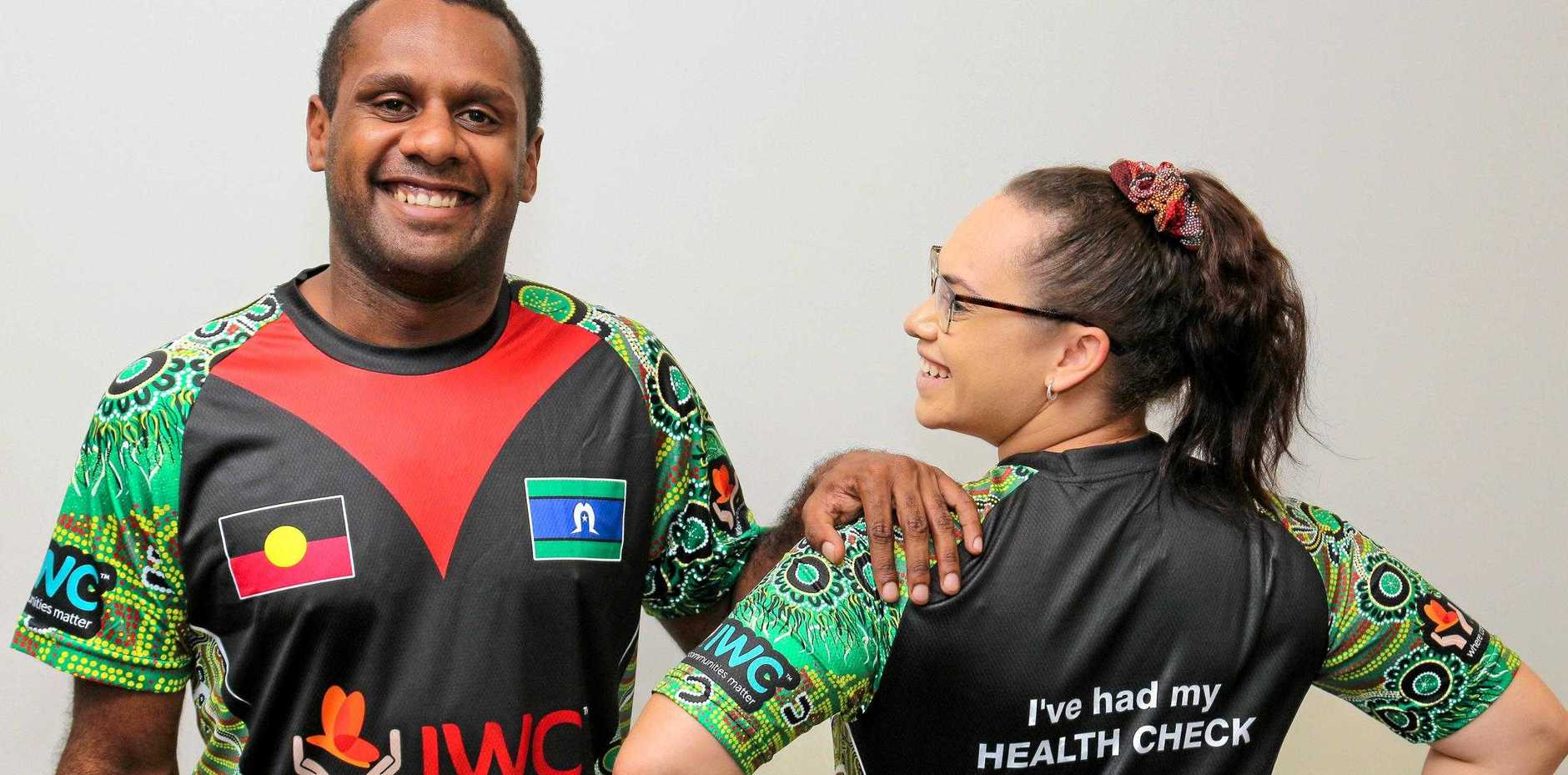 CHARITY'S COSTLY SHIRTS: IWC indigenous health worker, Kane Chapman and medical centre receptionist, Sharnese Mills wearing shirts that are distributed to patients.