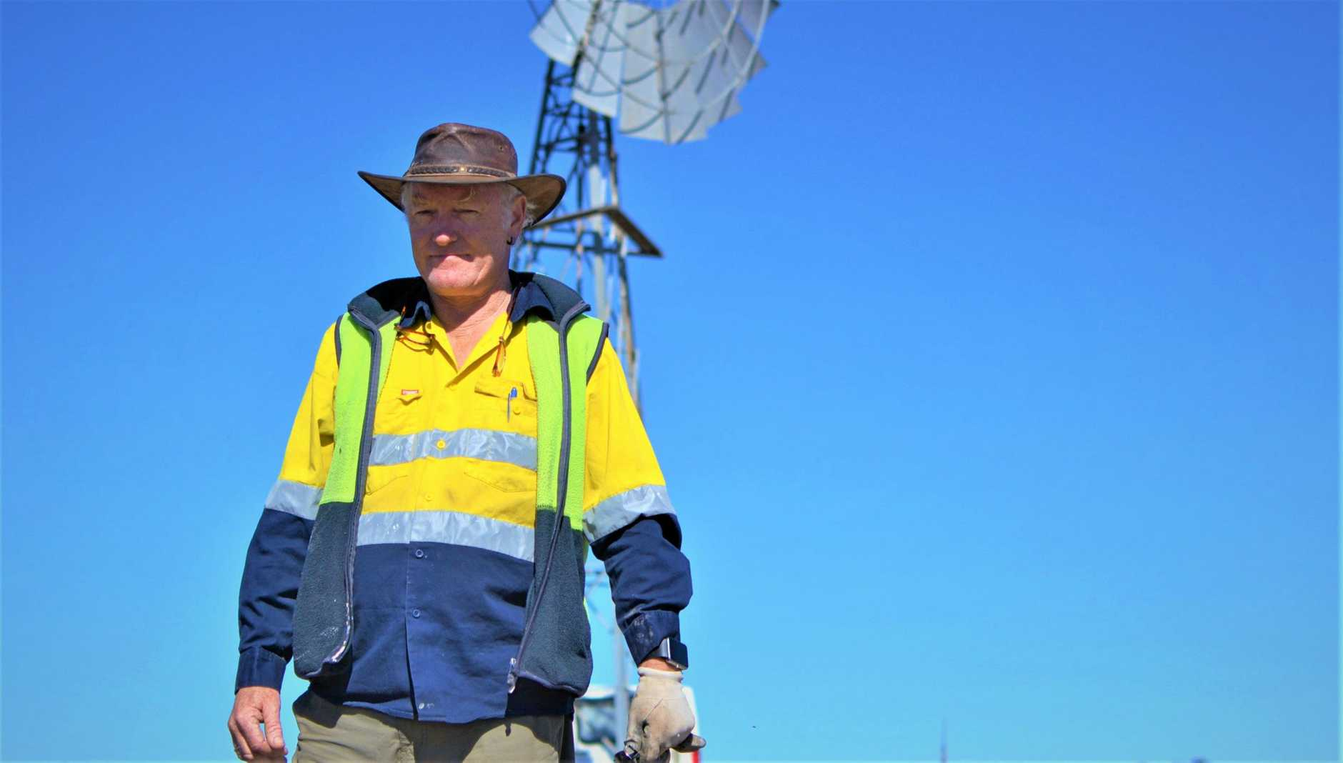 Chris Hudson from Yangan works on a windmill near Junabee drought paddock