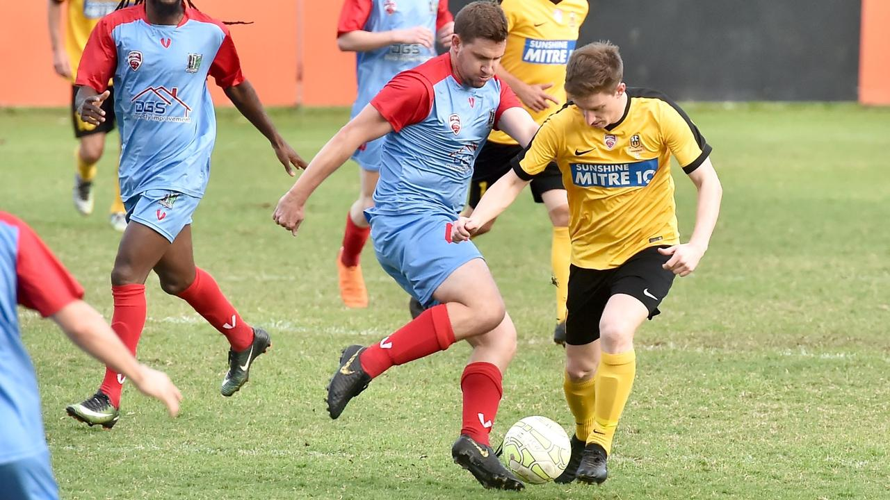 ON THE BALL: Sunshine Coast Wanderers Karl Vonhoff, right, and Ipswich Knights player Lincoln Rule. Picture: Warren Lynam.