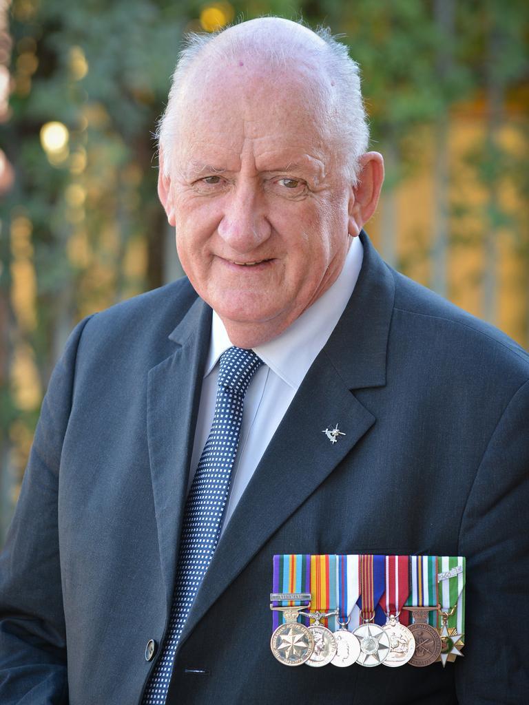 Tim Fischer wears his service medals.