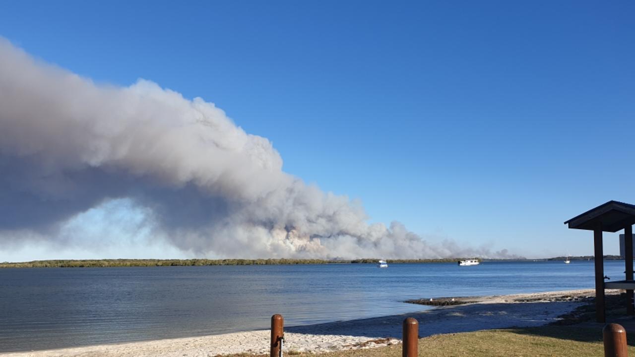 BUSHFIRE BATTLE: A fire on Bribie Island near Ocean Beach campsite, taken from Golden Beach. Photo: Contributed