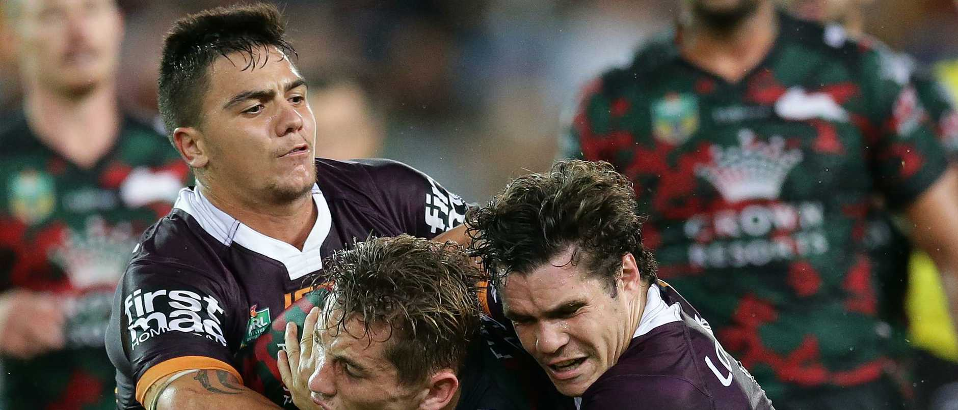 Kodi Nikorima (left) and James Roberts (right) have moved on from the Broncos.
