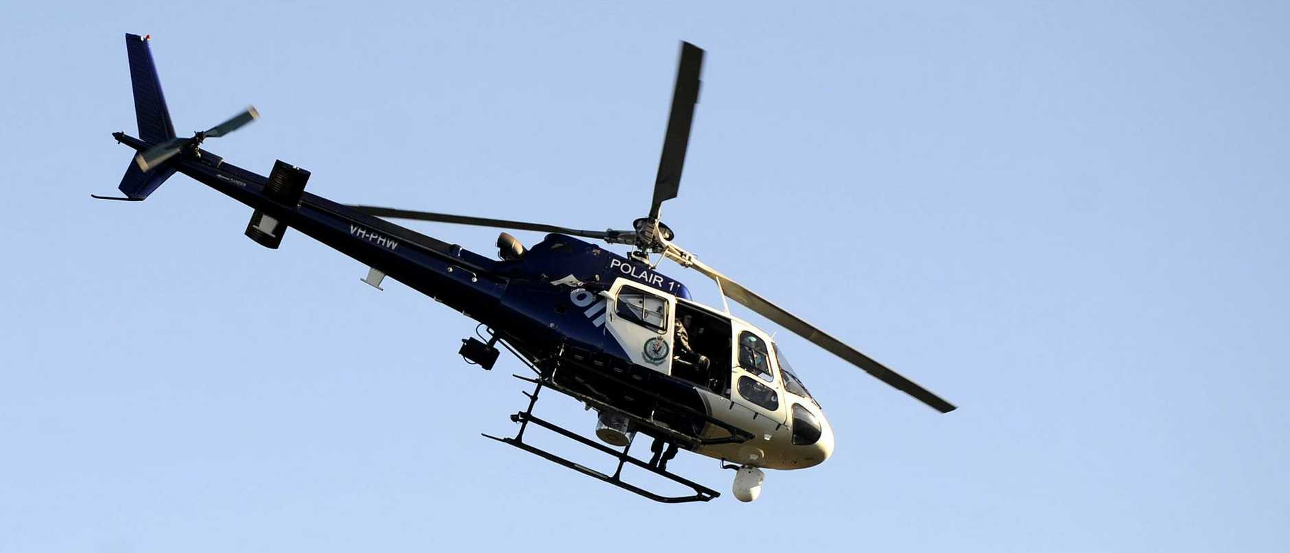 Polair 1 searches for missing bushwalker Michael Strettles above Brisbane Water National Park , Woy Woy South .