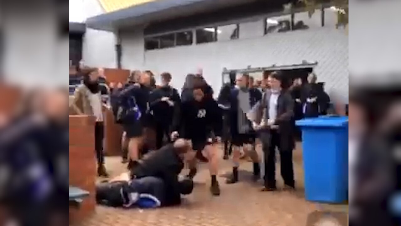 A screenshot of the vision showing the vice-principal trying to intervene in the brawl. Picture: Supplied