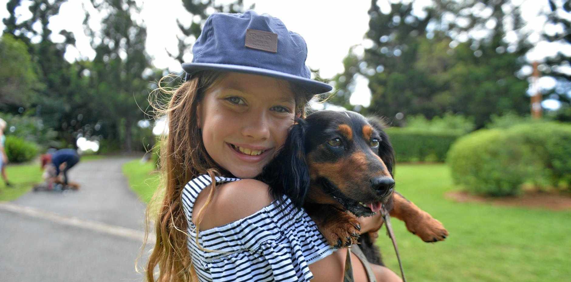Ruby Galletly-Hope with Franky the dachshund at Mackay Regional Botanic Gardens.