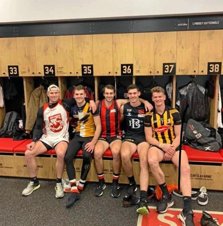 St Kilda midfielder David Armitage (pictured left with four of his Saints teammates) sported his Eastern Swans gear during a recent training session.