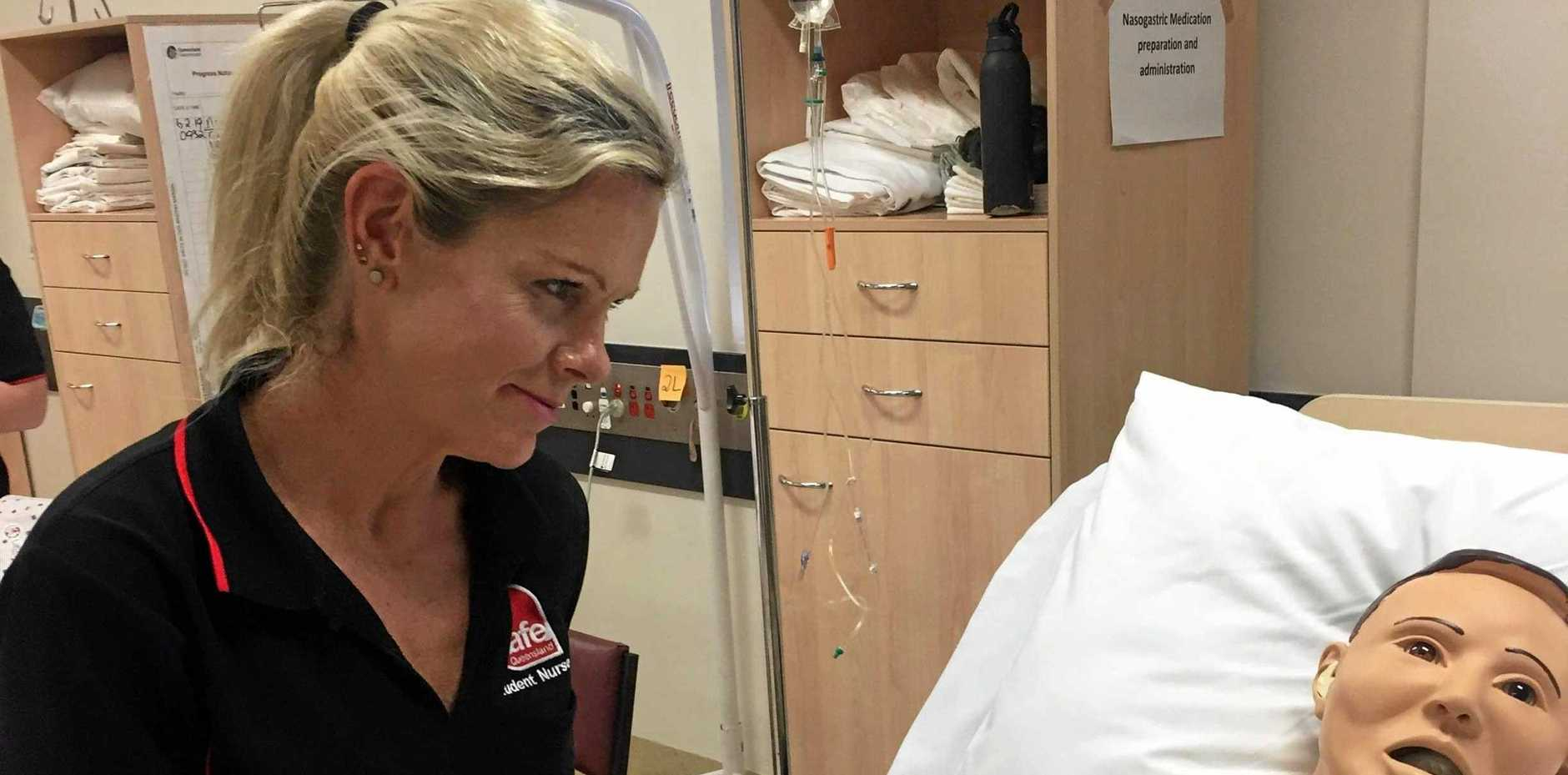 LEARNING JOURNEY: TAFE Queensland student Kim Bauer is excited to be learning about nursing. She balances study with being a mother.