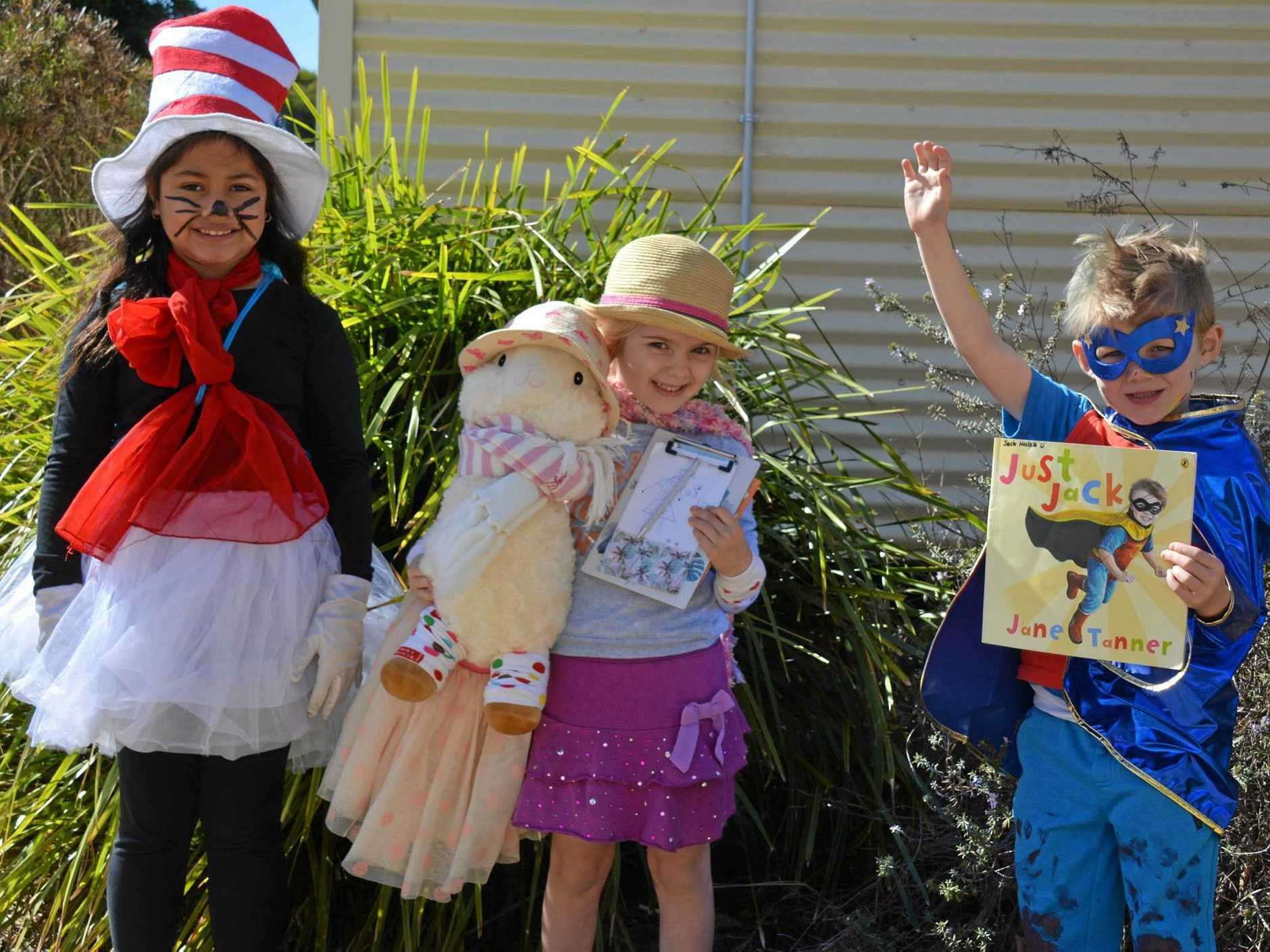Taabinga State School Prep 1R students Lea'aetoa, Grace and Jack dress up for book week on Friday August 23.