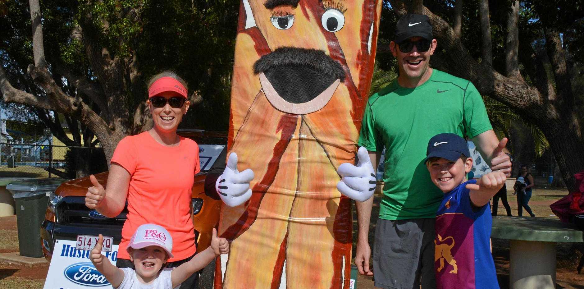BACON RUN: Carmen, Elliana, Craig and William Campbell meet BaconMan before the Rasher's Run at BaconFest last year.