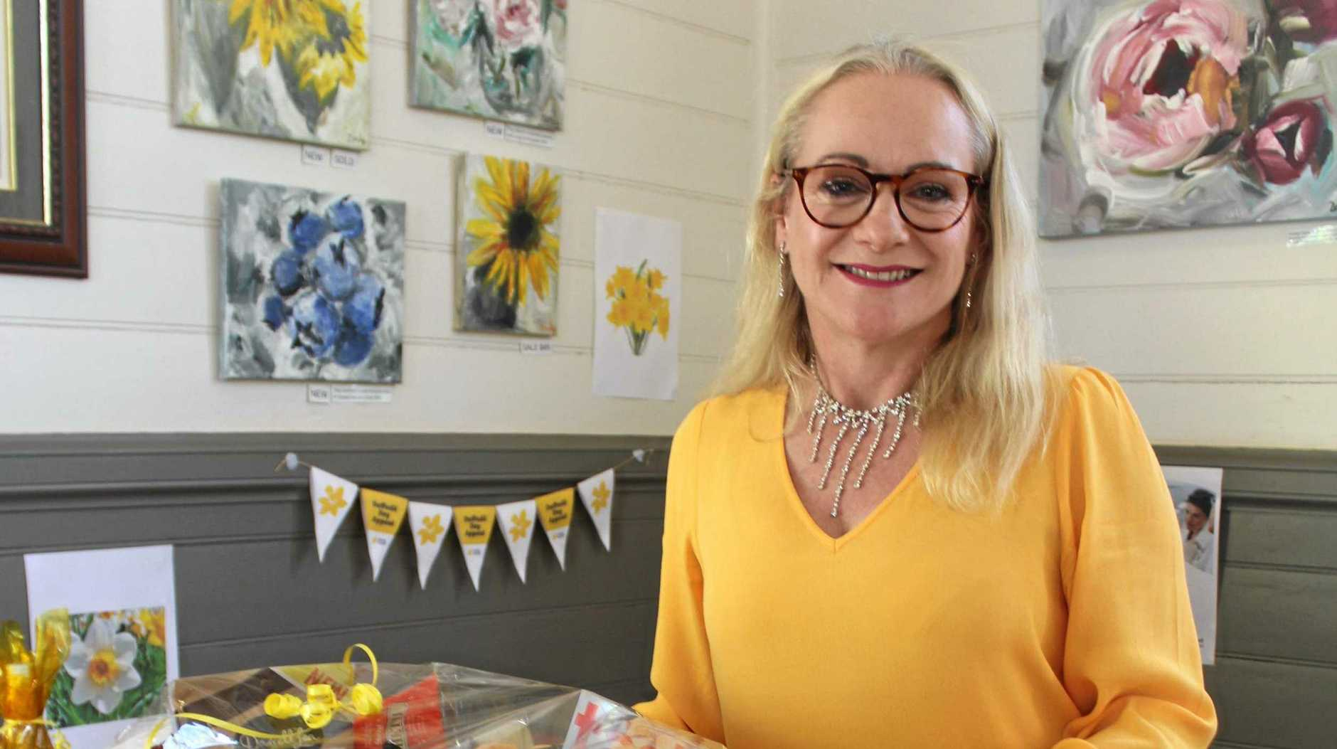 TOP FROCK: Whip Bird building owner Linda Lange rocking a beautiful daffodil coloured frock at the event.