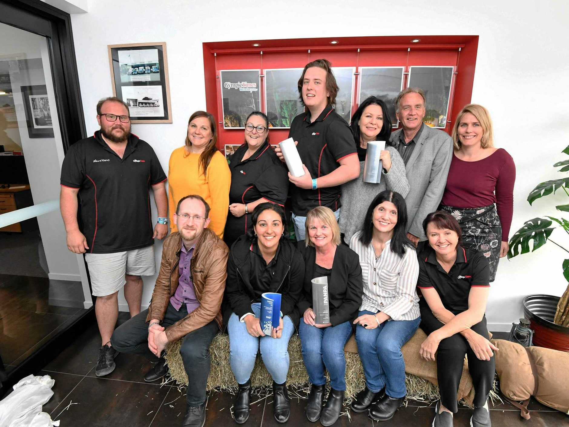LOCAL TEAM: (Back, from left) Troy Jegers, Carolyn Veille, Donna Jones, Joshua Preston, Shelley Strachan, Arthur Gorrie, Frances Klein, (front) Scott Kovacevic, Bec Singh, Tracey McKean, Rowena Robertson and Sharon Turner holding some of the earlier awards.
