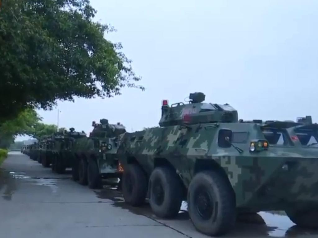 A still from Chinese state media footage showing military vehicles purportedly heading towards the Hong Kong border.