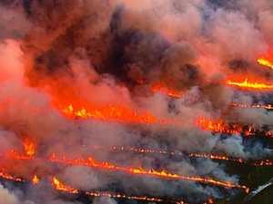 Raging bushfires send Coast into smoky haze