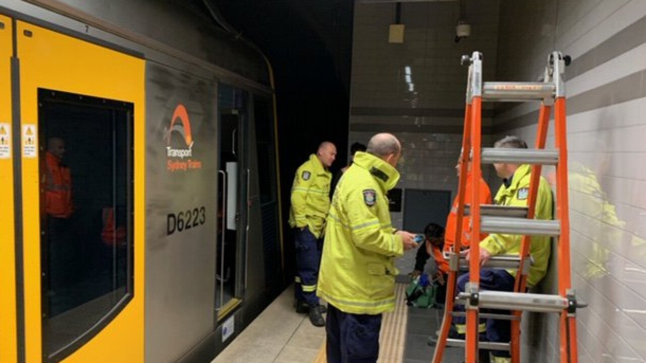 Crews work to repair the train at Town Hall on platform three.