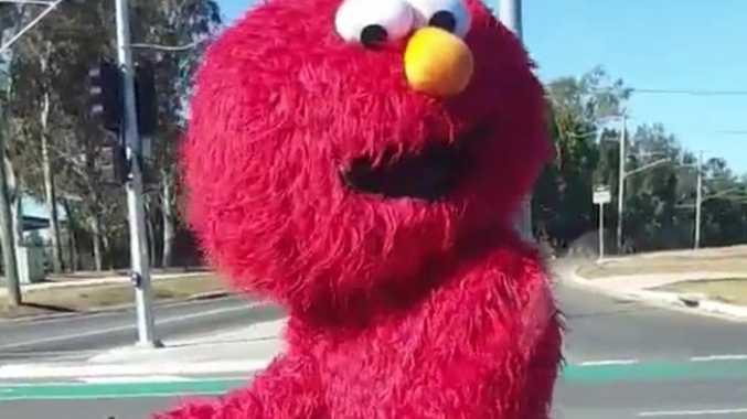 Motorcyclist's Elmo stunt stuns motorists