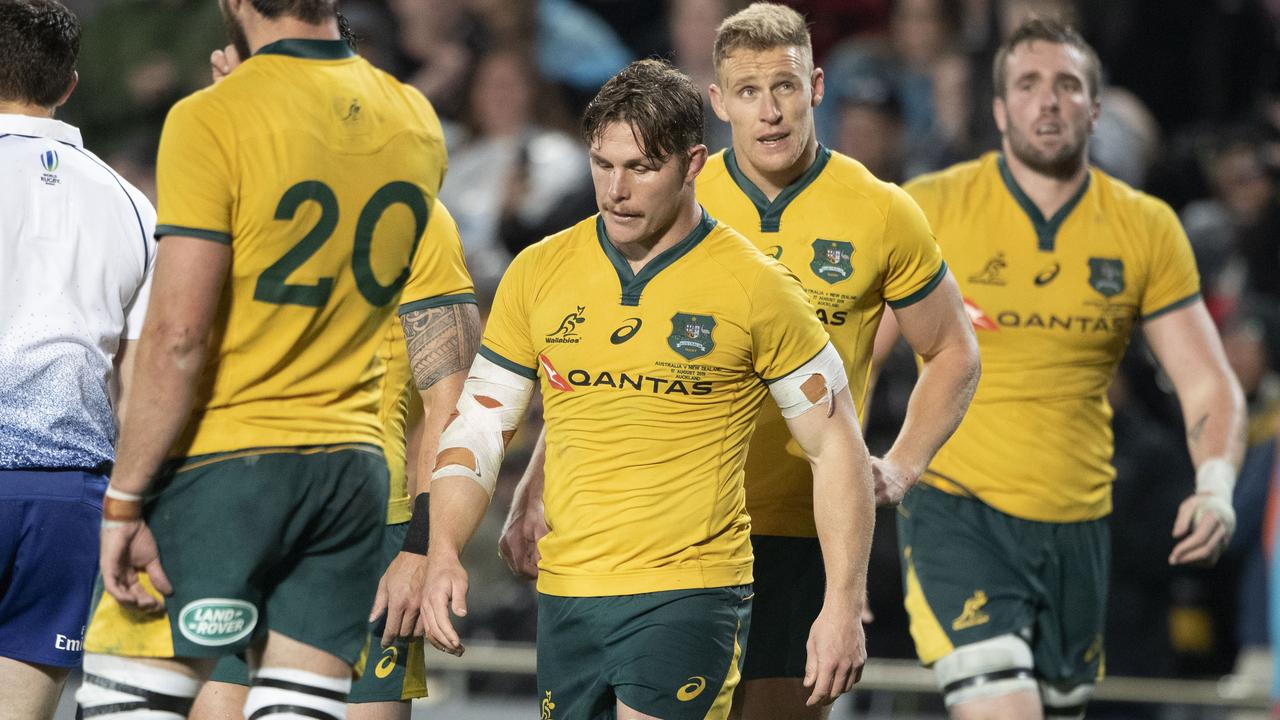 DEFEATED: Wallabies captain Michael Hooper, centre, leaves the field after losing to the All Blacks during a Bledisloe Cup rugby test at Eden Park in Auckland, New Zealand on Saturday. Picture: Brett Phibbs/SNPA via AP.