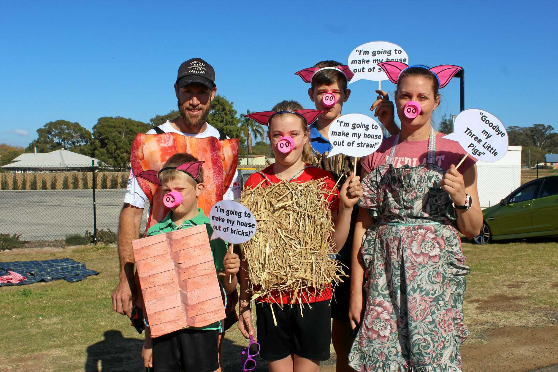 PIGGED OUT: Local family Mick and Aimee Freeman along side their children Evan, Belle and Josh dressed up as the three little pigs.