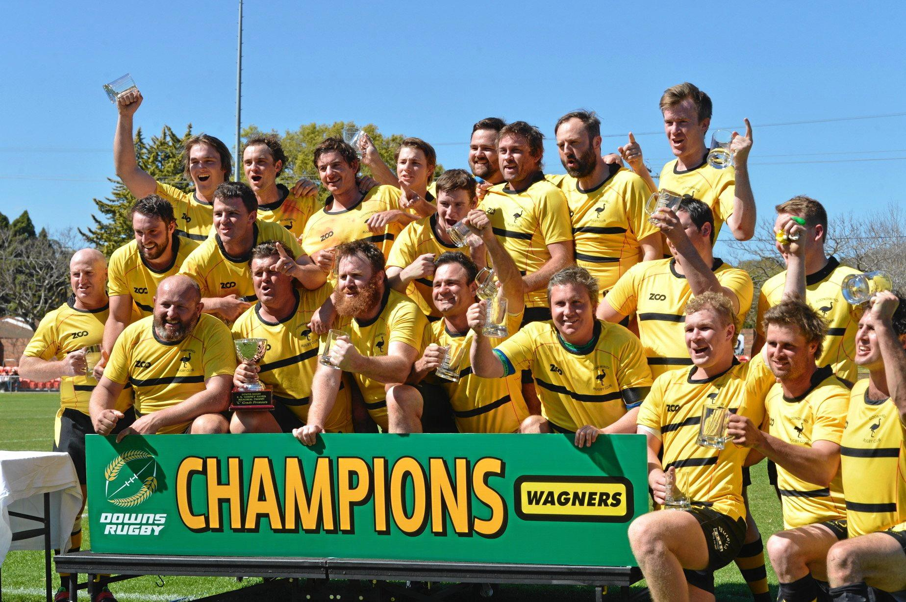 The Goondiwindi Emus celebrate their Downs Rugby C-grade grand final win over Dalby at Clive Berghofer Stadium today.