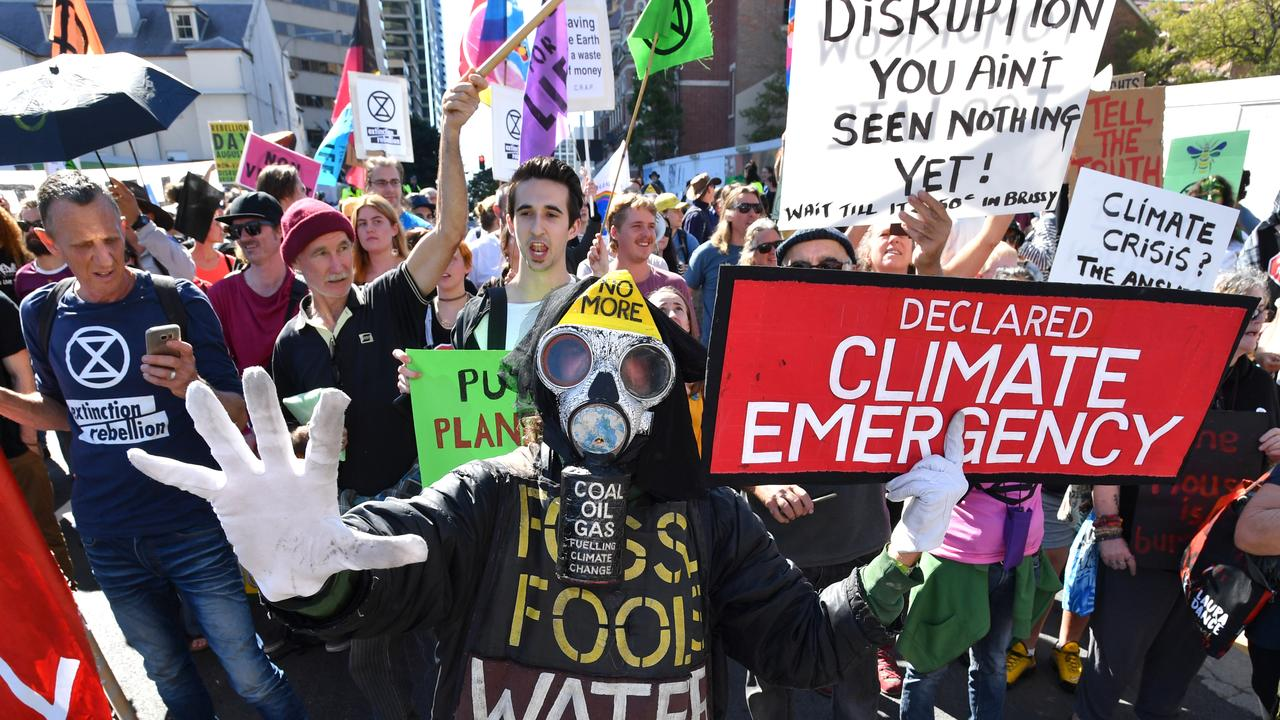 Extinction Rebellion protestors block the corner of Margaret and William Streets in Brisbane oin August 6, More protests are planned for coming weeks. Picture: AAP Image/Darren England