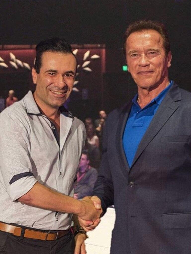 Edgar Natolo with Arnold Schwarzenegger