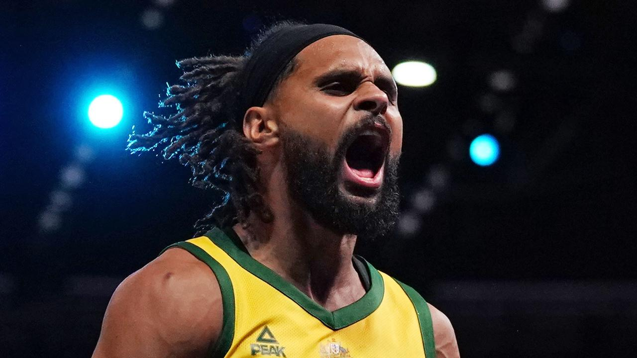Patty Mills celebrates during Australia's historic win. Picture: Scott Barbour/AAP
