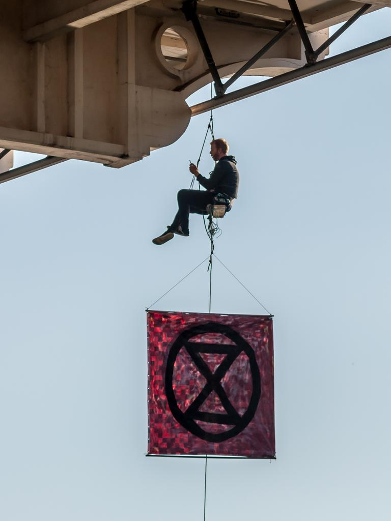 An Extinction Rebellion protester who abseiled off William Jolly Bridge in Brisbane's CBD on August 19. Picture: Supplied.