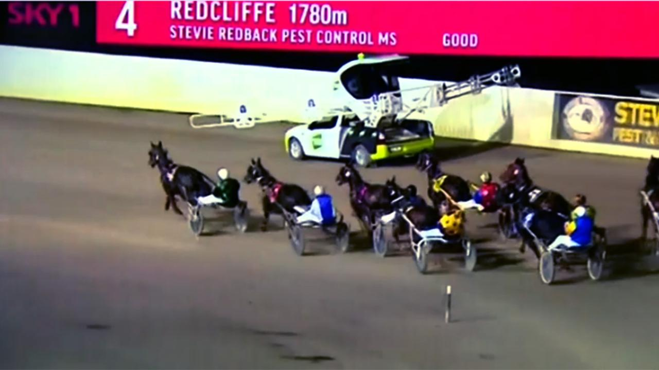 Lara Whitaker was in her father's arms when she was hit by the boom arm of a pace car during the race meet at Redcliffe Harness Racing Club.