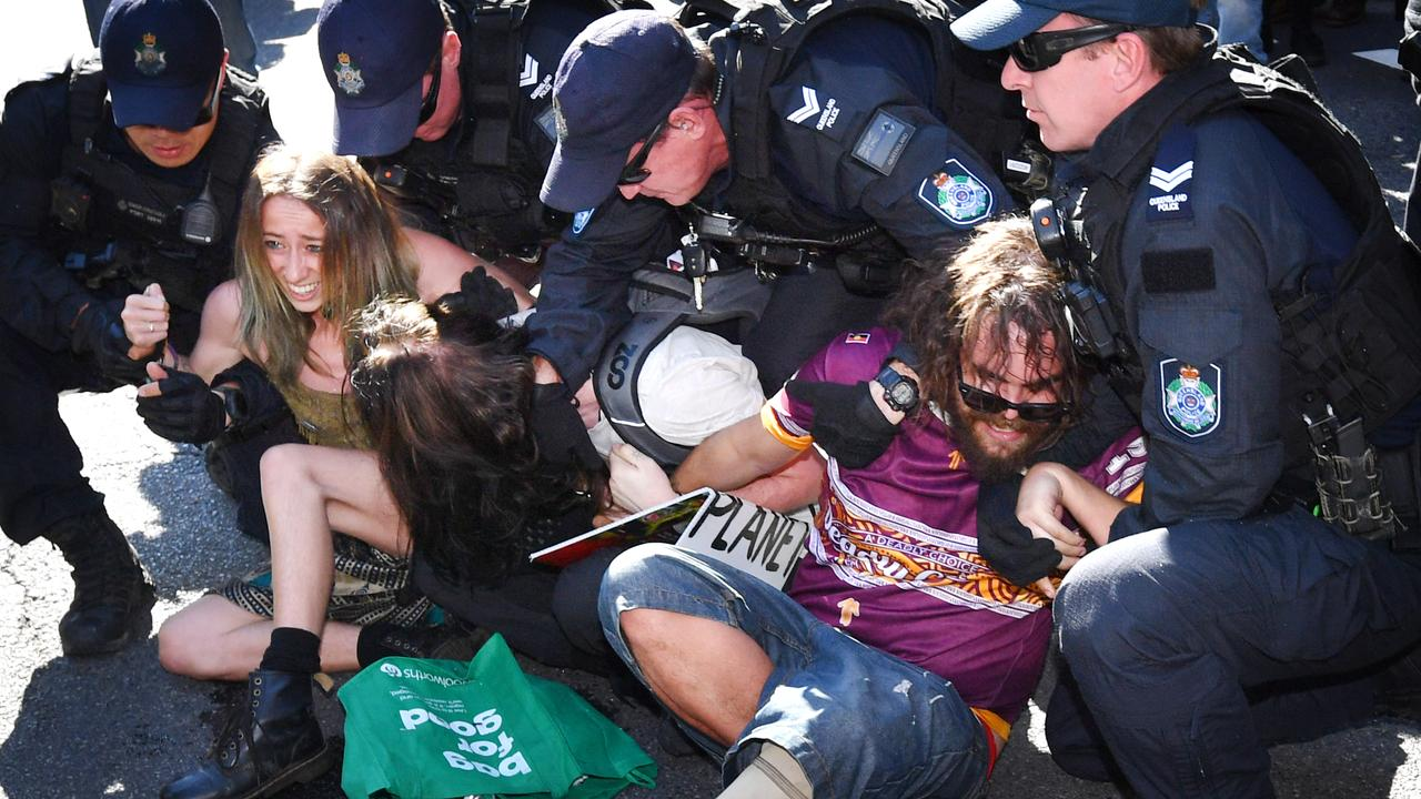 Police arresting Extinction Rebellion protestors in Brisbane's CBD on August 6. Picture: Darren England/AAP