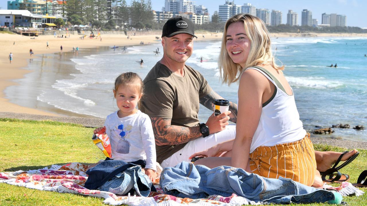 Buderim family Jay Want, Chloe Scott and Aalilah Want, 2, enjoying the summer-like weather at Alexandra Headland. Photo: John McCutcheon / Sunshine Coast Daily